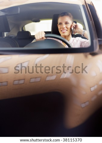 woman driving car and talking on mobile phone. Copy space - stock photo