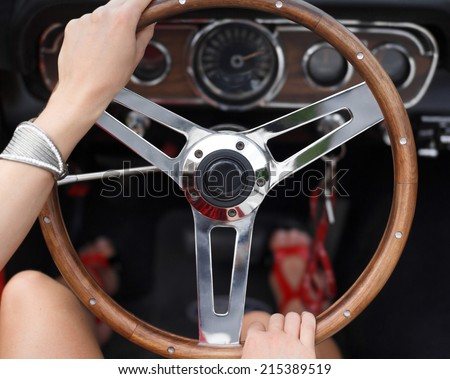 Woman driving fast, holding steering wheel, closeup