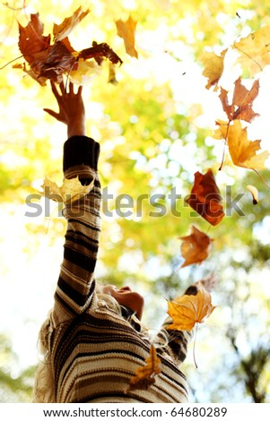 woman drop up leaves - stock photo