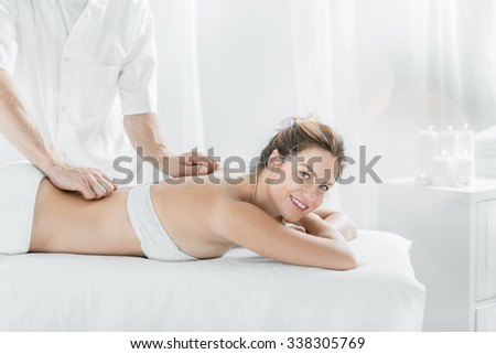 Woman during relaxing massage in spa center - stock photo