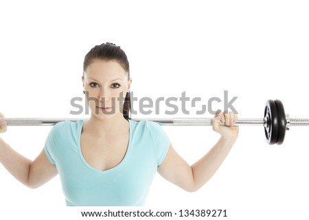Woman during strength training with barbells - stock photo