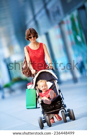 Woman during the shopping with the little girl. - stock photo