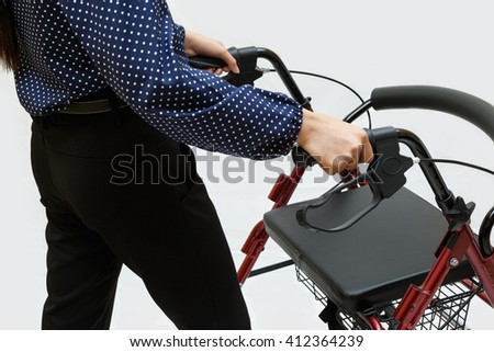 woman during walking with walker - stock photo