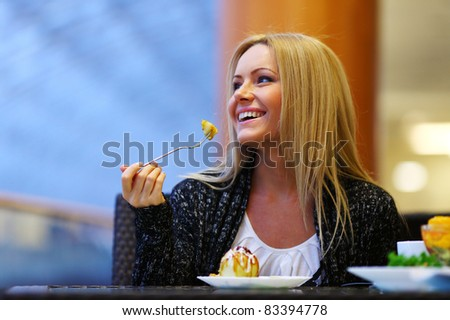 woman eat desert in caffe - stock photo