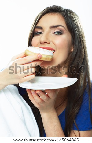 Woman eat donut. Close up portrait. Isolated white background.