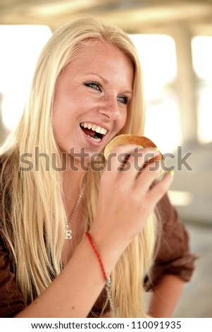 woman eating a cake - stock photo