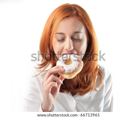 Woman eating a donut - stock photo