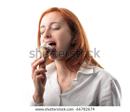Woman eating an ice-cream - stock photo
