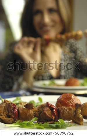 woman eating beef