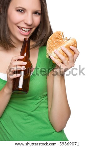Woman eating burger and beer - stock photo