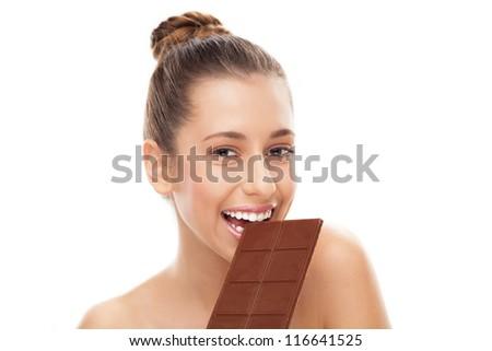 Woman eating chocolate bar - stock photo