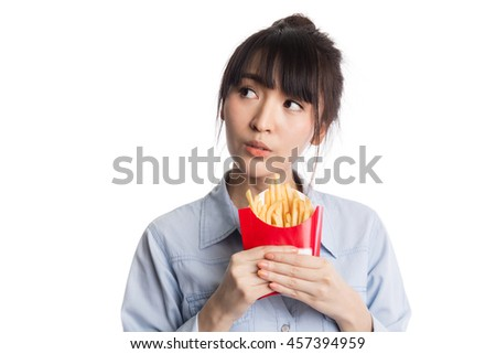 Woman eating french fries, potato fries, looking up to copy space, isolated on white background - stock photo