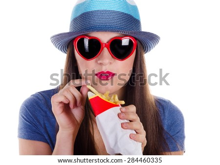 woman eating fries potatoes isolated on a white - stock photo