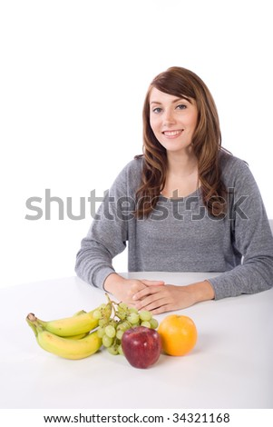 Woman eating fruit in a modern kitchen