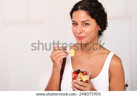 woman eating fruits - stock photo