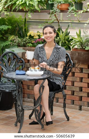woman eating in a patio - stock photo