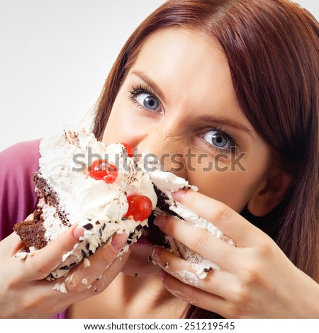 Woman eating pie - stock photo