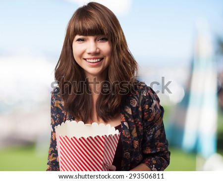 woman eating popcorns - stock photo
