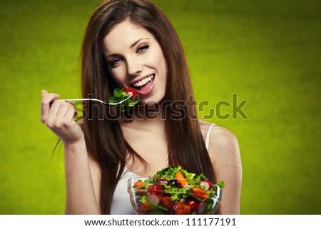 woman eating salad - stock photo