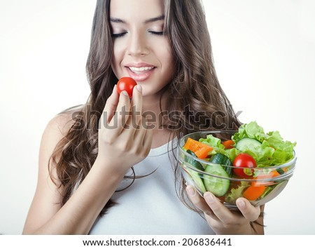 woman eating salad with closed eyes - stock photo