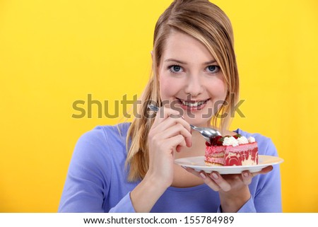 Woman eating strawberry cake - stock photo