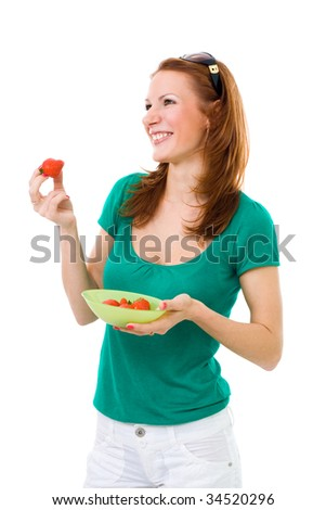 Woman eating strawberry side view wide smile green shirt