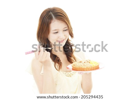 Woman eating sweets