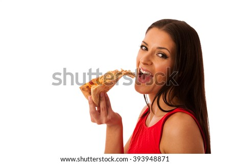 Woman eating tasty piece of pizza. Unhealthy fast food meal. - stock photo