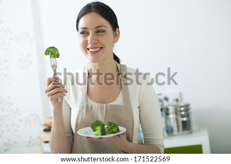 Woman Eating Vegetable