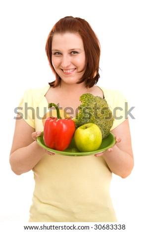 Woman eating vegetables on white background