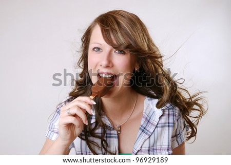 woman eats a popsicle - stock photo