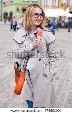 Woman eats icecream - stock photo