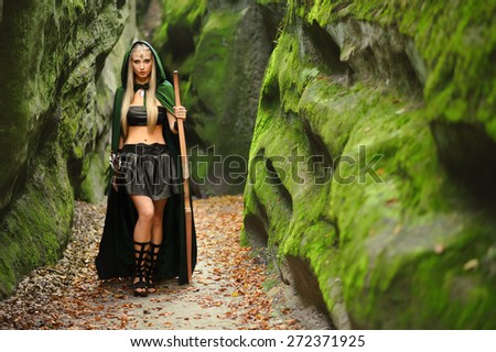 Woman elf warrior with a bow is a fabulous mountains - stock photo