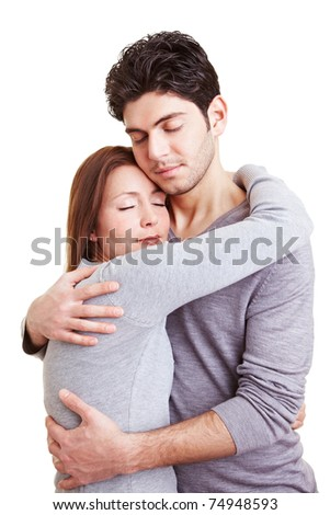 Woman embracing a man with her eyes closed