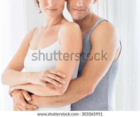 Woman embracing her partner - stock photo