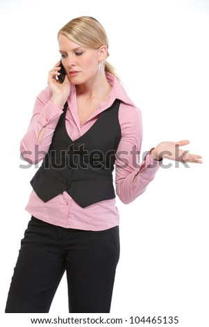 Woman employee speaking mobile phone - stock photo