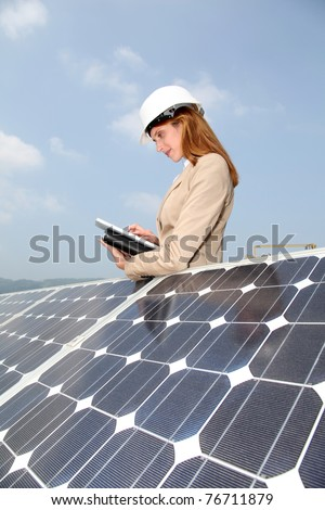 Woman engineer checking solar panels setup