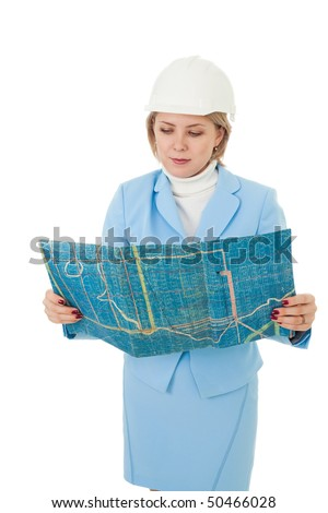 Woman engineer looking and construction plan - stock photo