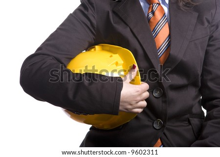 Woman engineer or architect with yellow safety hat - stock photo