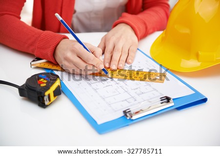 Woman engineer sketching draft. Young female professional designer working on new architectural project.  - stock photo