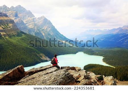 Woman enjoy a beautiful mountain lake. Peyto Lake, Canadian Rockies, Alberta, Canada. - stock photo