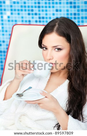 Woman enjoy cup of coffee in spa center - stock photo