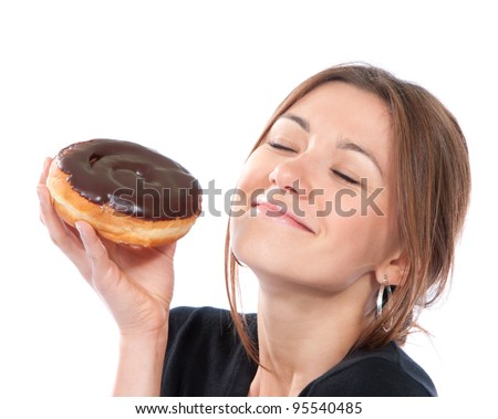 Woman enjoy donut. Unhealthy junk food concept isolated on a white background - stock photo