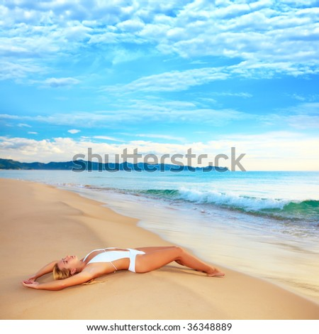 Woman enjoy first sun at sunrise time - stock photo
