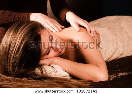 woman enjoy in  back massage in spa - stock photo