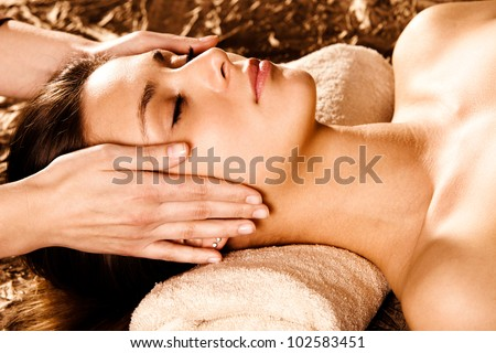 woman enjoy in face massage in spa salon - stock photo