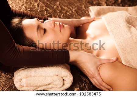 woman enjoy in shoulder massage in spa salon