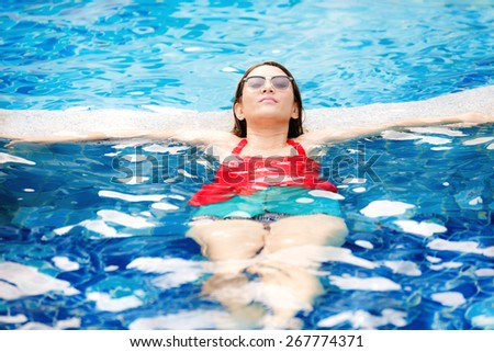 Woman enjoy relaxing in the pool - stock photo