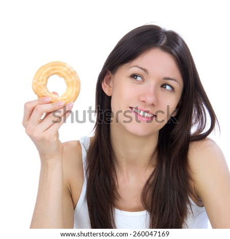 Woman enjoy sweet donut and looking at the corner. Unhealthy junk food concept isolated on a white background - stock photo