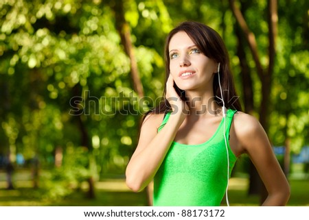 woman enjoy the music in summer park - stock photo